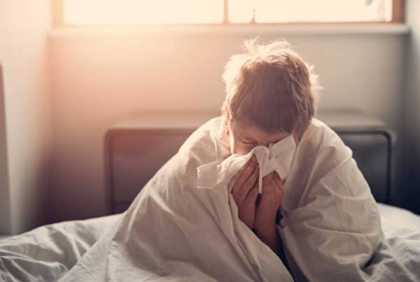 A man suffering from a cold due to a weak immune system.