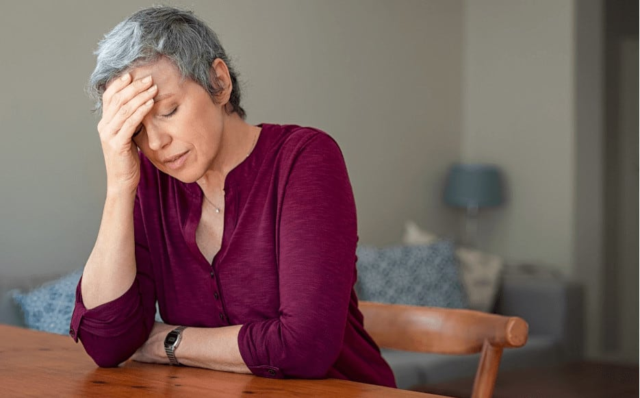 A middle-aged woman suffering from symptoms of the menopause.
