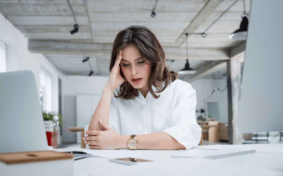 a woman feeling side effects from taking medication.